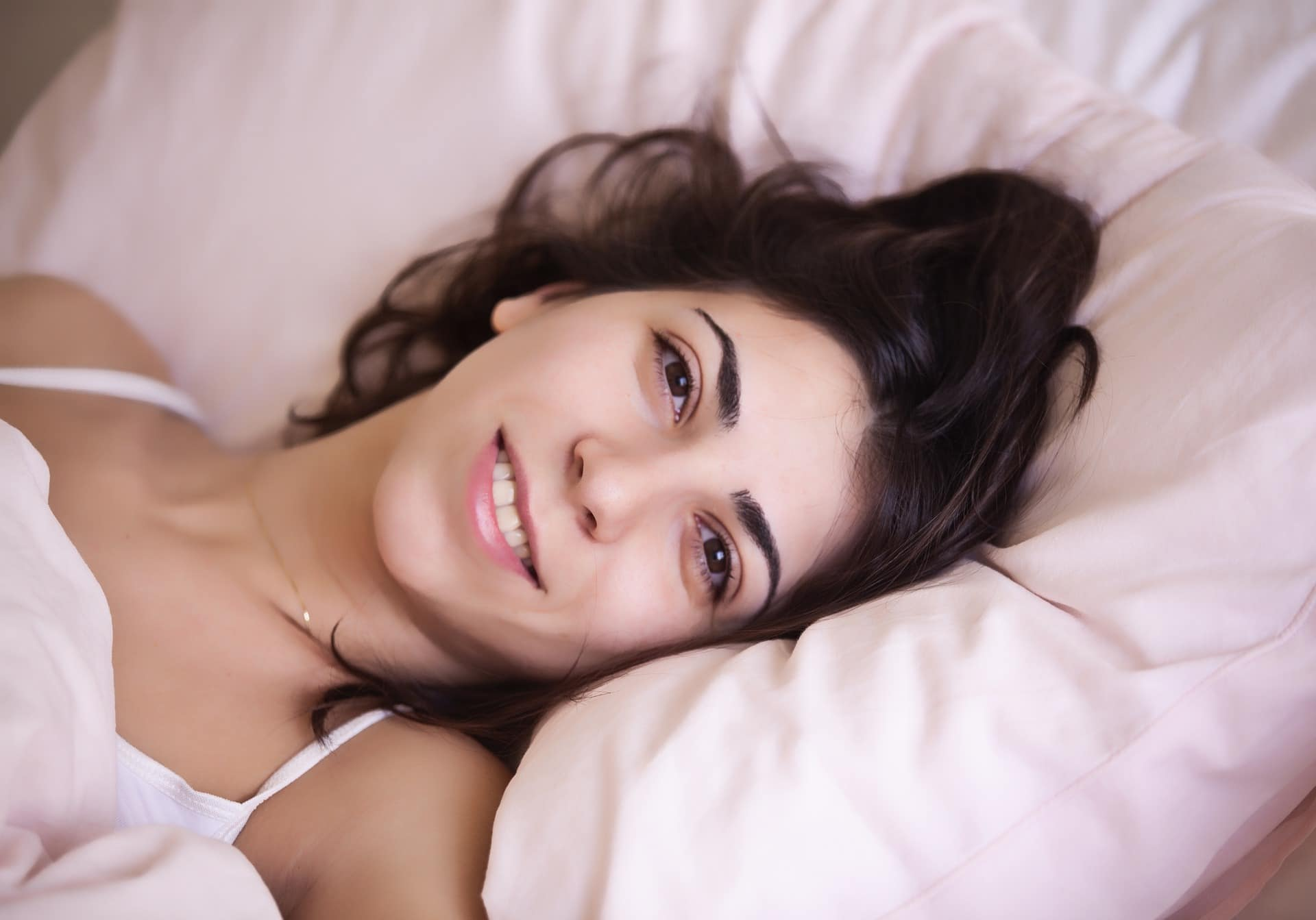 smiling woman lying down