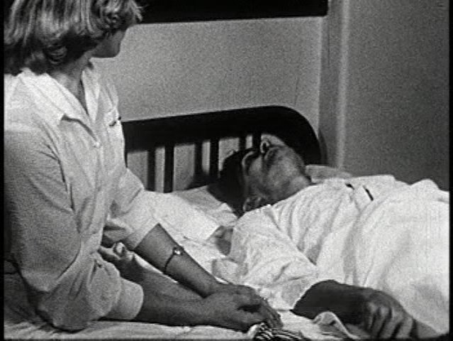 black and white image of a nurse and her patient